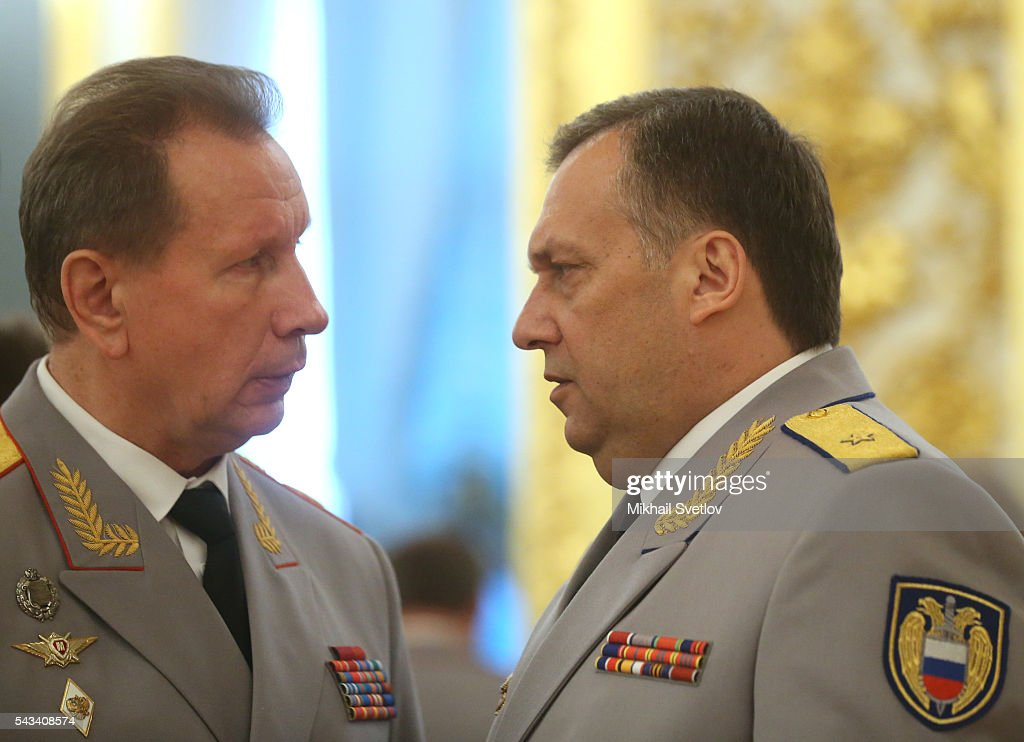National Guard of Russia Commander-in-Chief Viktor Zolotov (L) talks to Federal Guard Service (FSO) Chief Dmitry Kochnev (R) during the reception for graduates of military academies and universtities at the Grand Kremlin Palace on June 28, 2016 in Moscow, Russia.