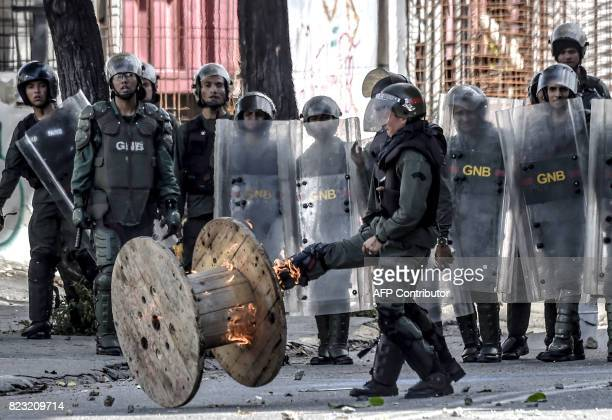 National Guard personnel in riot gear clash with opposition demonstrators during an antigovernment protest in Caracas on July 26 2017 Venezuelans...