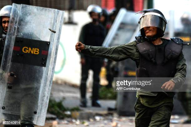 National Guard riot police and opposition demonstrators clash ensuing an antigovernment protest in Caracas on July 26 2017 Venezuelans blocked off...