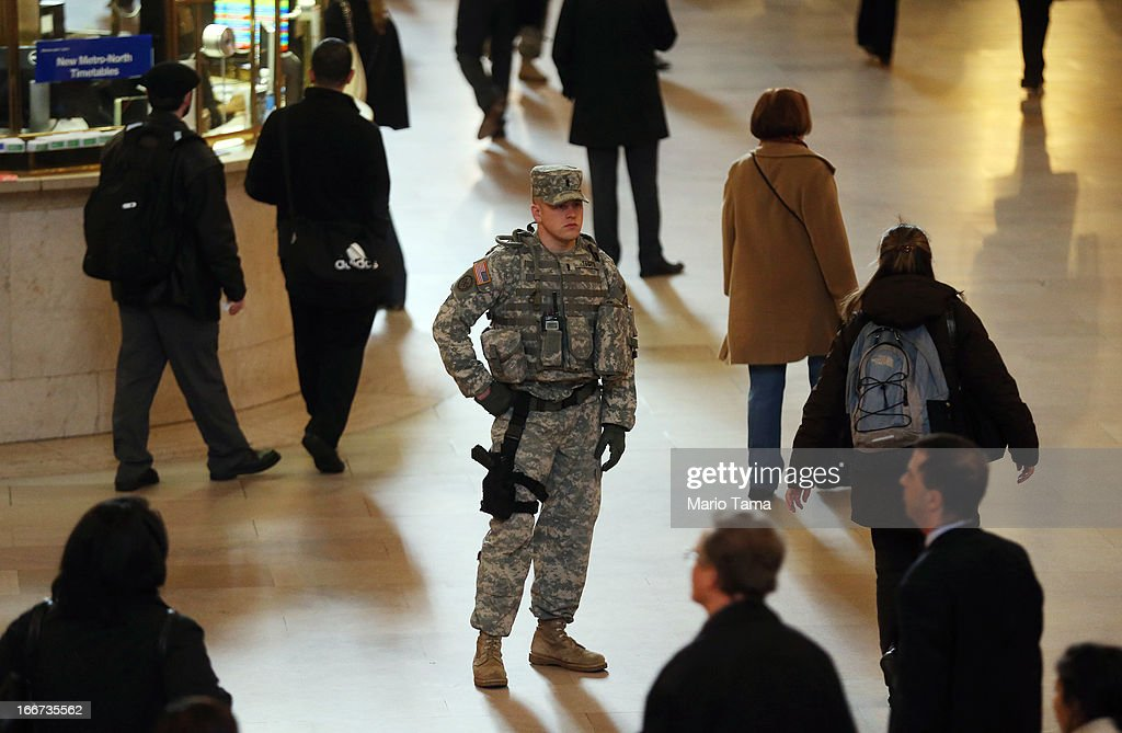 A National Guard soldier keeps watch during the morning commute in Grand Central Terminal on April 16, 2013 in New York City. The city announced it has continued increased security one day after the Boston Marathon bombings.