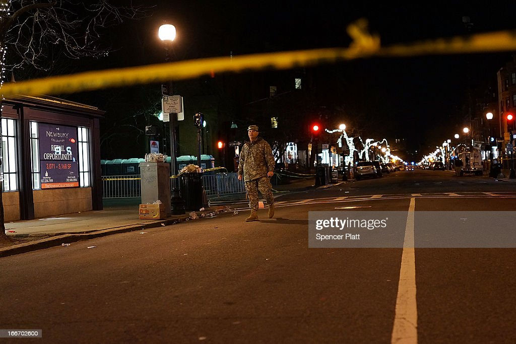 A National Guard soldier stands near the scene of a twin bombing at the Boston Marathon, on April 16, 2013 in Boston, Massachusetts. Three people are confirmed dead and at least 141 injured after the explosions went off near the finish line of the marathon yesterday. The bombings at the 116-year-old Boston race, resulted in heightened security across the nation with cancellations of many professional sporting events as authorities search for a motive to the violence.