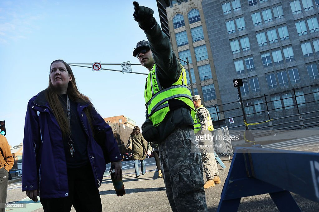 National Guard soldiers guard a roadblock near the scene of a twin bombing at the Boston Marathon on April 16, 2013 in Boston, Massachusetts. The twin bombings, which occurred near the marathon finish line, resulted in the deaths of three people while hospitalizing at least 128. The bombings at the 116-year-old Boston race, resulted in heightened security across the nation with cancellations of many professional sporting events as authorities search for a motive to the violence.