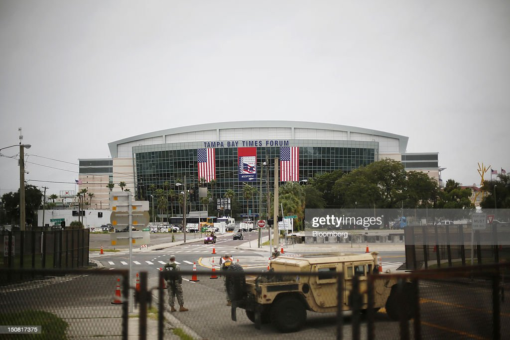 National Guard soldiers guard an approach to the Tampa Bay Times Forum under overcast skies in Tampa, Florida, U.S., on Sunday, Aug. 26, 2012. Tropical Storm Isaac regained strength as it entered the Gulf of Mexico, forcing oil and gas production sites in its path to close and threatening the coasts of four U.S. states with a possible Category-2 hurricane. Photographer: Victor J. Blue/Bloomberg via Getty Images