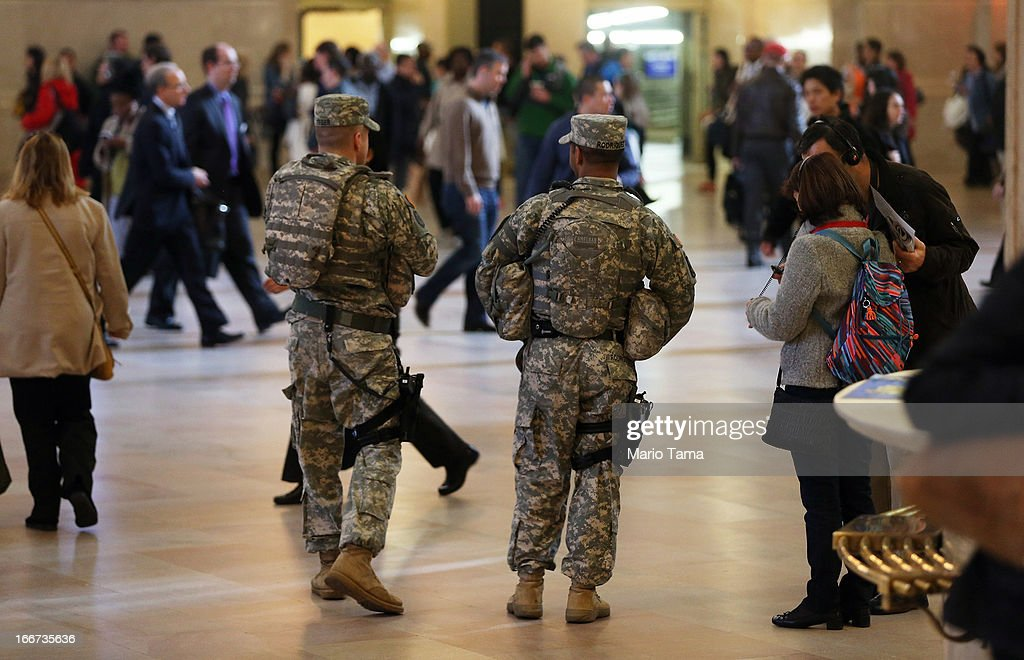 National Guard soldiers keep watch during the morning commute in Grand Central Terminal on April 16, 2013 in New York City. The city announced it has continued increased security one day after the Boston Marathon bombings.