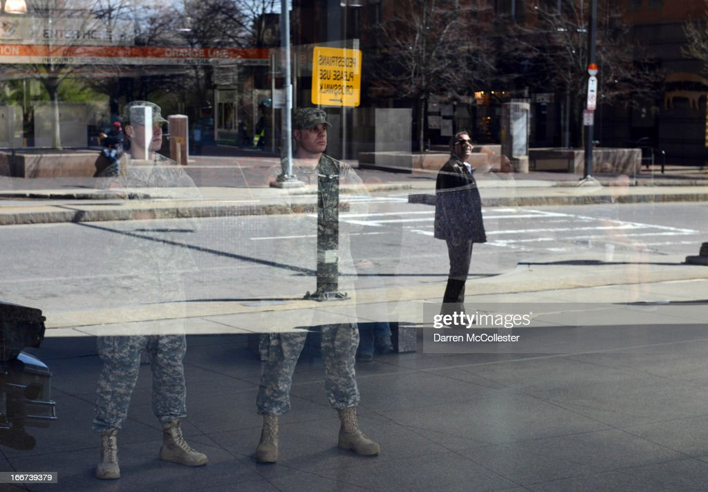 National Guard soldiers stand looking out from from inside Back Bay Station April 16, 2013 in Boston, Massachusetts. Security is tight in the City of Boston following yesterday's two bomb explosions at the finish of the Boston Marathon, that killed three people and wounding hundreds more.