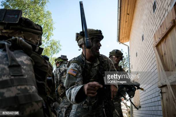 National Guard together with Lithuanian Military storms a house held by the 'separatists' Image taken during a NATO hosted military training exercise