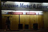 A National Guard trooper keeps vigil around local business in Ferguson Missouri on November 25 2014 during demonstrations a day after violent...