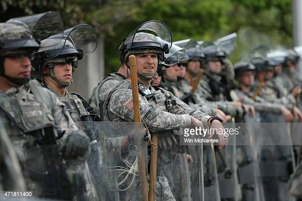 National Guard troops keep watch on May 1 2015 in Baltimore Maryland Baltimore authorities are releasing a report on the death of Freddie Gray this...