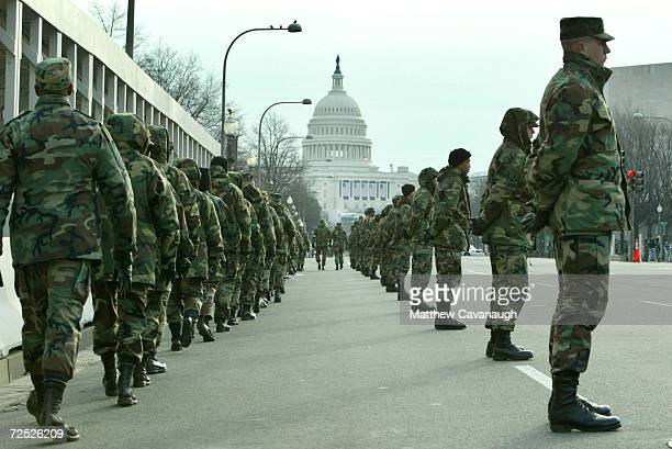 National Guard troops line Pennsylvania Avenue during an inaugural parade rehearsal January 16 2005 in Washington DC US President George W Bush will...