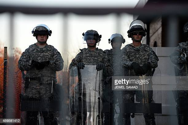 National Guard troops secure a parameter around the police station in Ferguson Missouri a day after violent protests and looting following the grand...