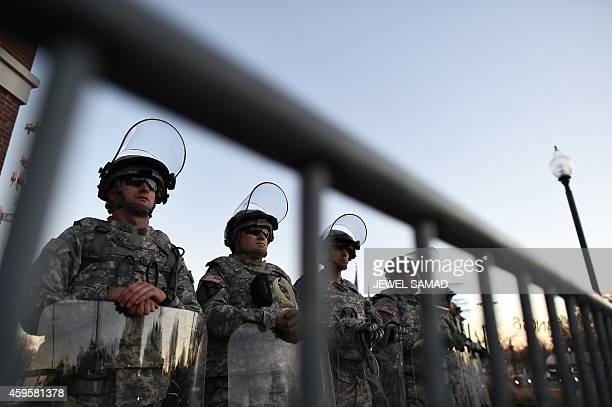 National Guard troops secure the police station in Ferguson Missouri a day after violent protests and looting following the grand jury decision in...