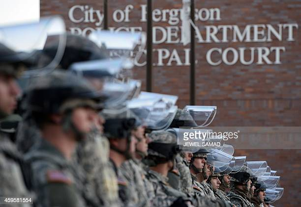 National Guard troops secure the police station in Ferguson Missouri on November 25 2014 a day after violent protests and looting following the grand...