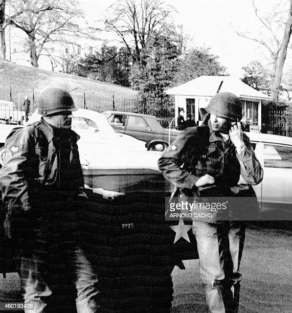 National guard troops stand guard outside the White House in a Washington DC on April 05 1968 after US President Lyndon B Johnson called out troops...