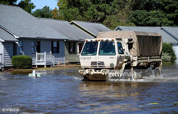 A National Guard vehicle drives through flood waters on Wednesday Oct 12 2016 at the Wyndham Circle duplex complex in Greenville NC