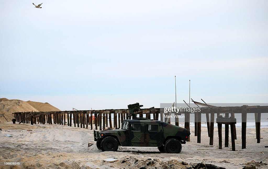 A National Guard vehicle stands watch near the board walk that was damaged by Superstorm Sandy on November 25, 2012 in Ortley Beach, New Jersey. New Jersey Gov. Christie estimated that Superstorm Sandy cost New Jersey $29.4 billion in damage and economic losses.