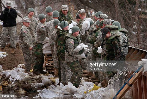 National Guardsmen help to repair a break in the levee on the campus of the Oak Grove Lutheran School March 29 2009 near Fargo North Dakota The Red...