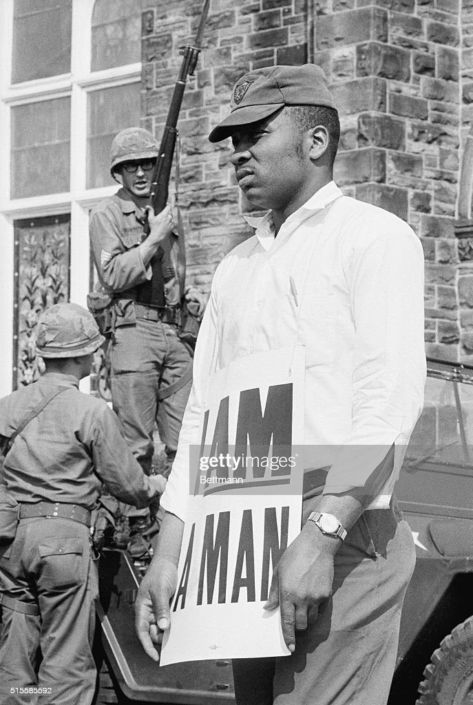 National Guardsmen look on as AfricanAmerican protesters begin a march to downtown Memphis wearing placards reading 'I AM A MAN' It was the third...