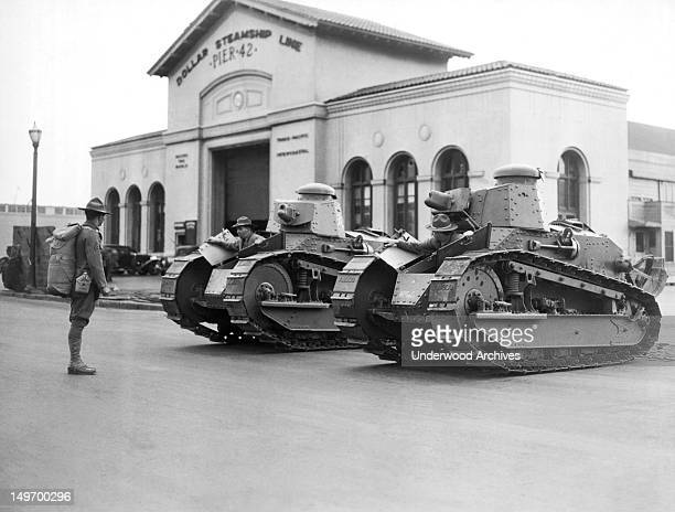 National Guardsmen man these tanks in front of Pier 42 after much rioting during the general waterfront strike San Francisco California July 20 1934