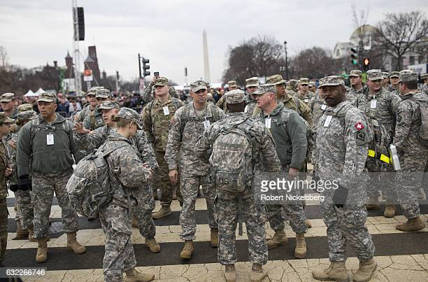 National Guardsmen prepare to take their security assignments in the Mall during the inauguration ceremony January 20 2017 in Washington DC...