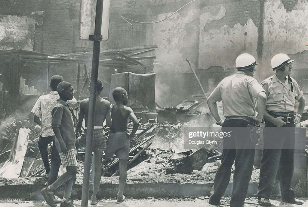 National Guardsmen restore an uneasy peace to riot-torn cleveland; Negro district exploded into violence; destruction and looting for the second night in a row