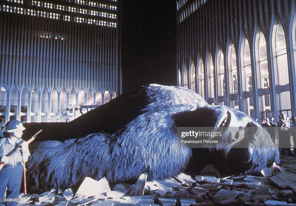 National Guardsmen stand around the wounded giant gorilla as he lies in a pile of rubble between the Twin Towers of the World Trade Center in a still from the film, 'King Kong,' directed by John Guillermin.