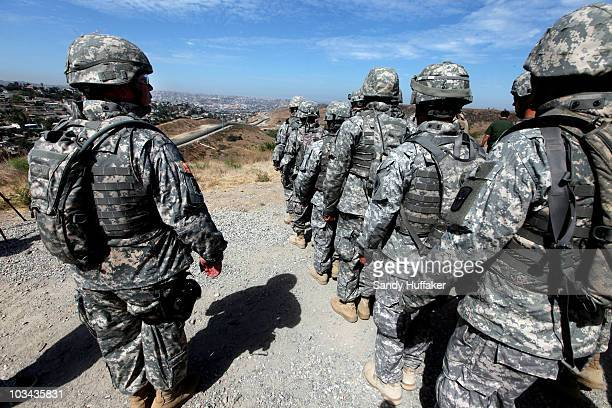 National Guardsmen stand in formation along the USMexico border during a visit by California Gov Arnold Schwarzenegger August 18 2010 in San Ysidro...