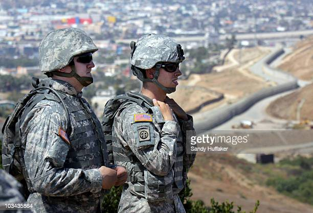 National Guardsmen stand on patrol along the USMexico border during a visit by California Gov Arnold Schwarzenegger August 18 2010 in San Ysidro...