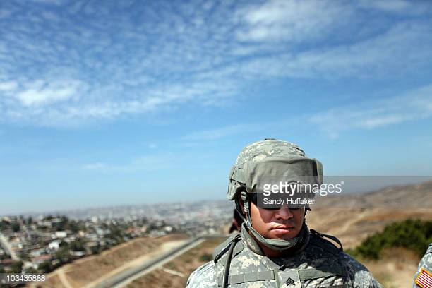 National Guardsmen stands in formation along the USMexico border during a visit by California Gov Arnold Schwarzenegger August 18 2010 in San Ysidro...