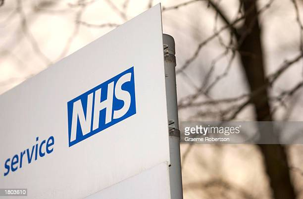 National Health Service sign is shown February 19 2003 in London England A report scheduled to be released tomorrow is expected to have complaints...