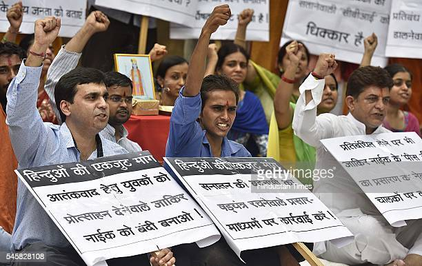 National Hindu Andolan organization members shouting slogans against Islamic Preacher Dr Zakir Naik against Hindu attack in Bangladesh during the...