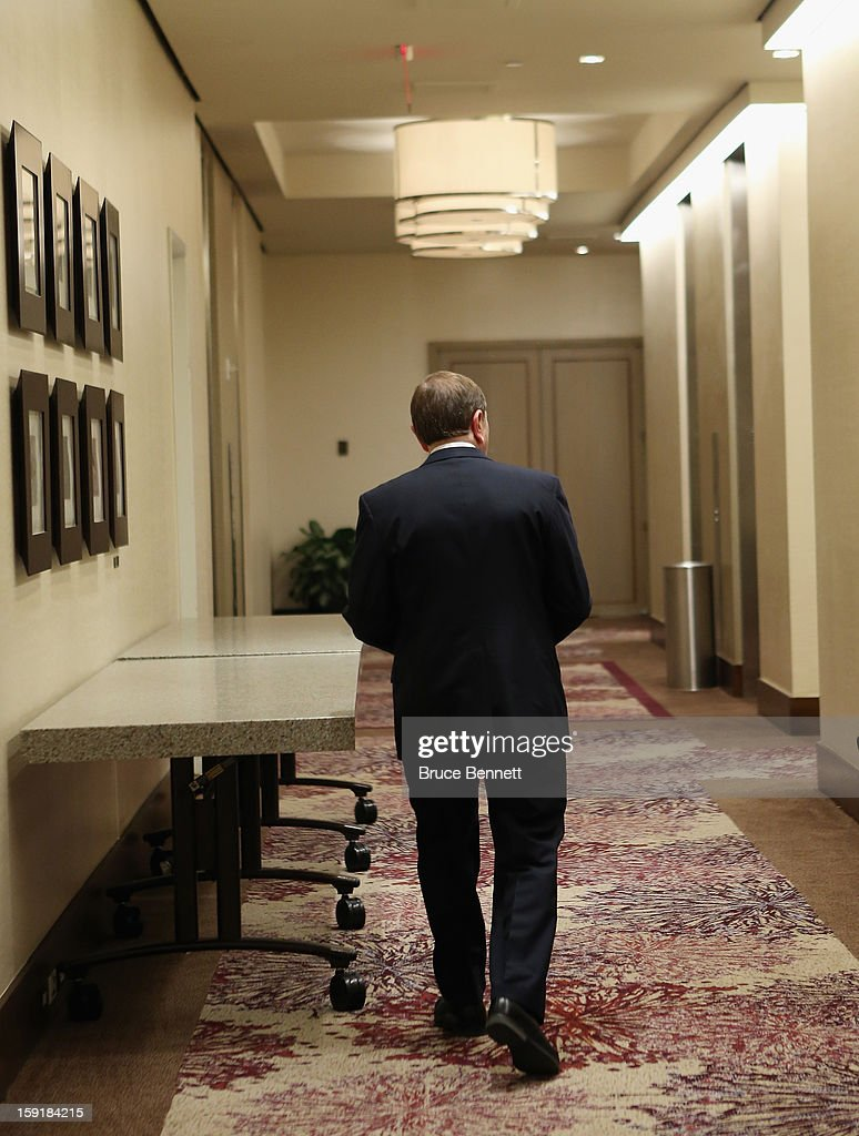 National Hockey League Commissioner <a gi-track='captionPersonalityLinkClicked' href=/galleries/search?phrase=Gary+Bettman&family=editorial&specificpeople=215089 ng-click='$event.stopPropagation()'>Gary Bettman</a> leaves after speaking at a press conference announcing the start of the NHL season at the Westin Times Square on January 9, 2013 in New York City.