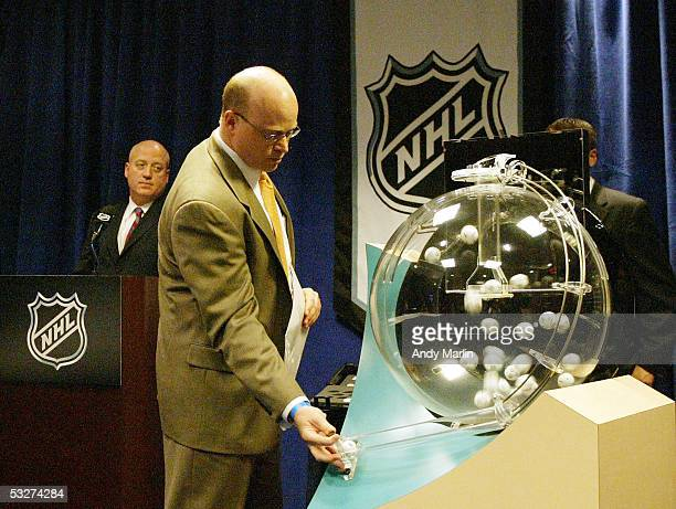 National Hockey League Executive Vice President Bill Daly presides over the NHL draft lottery with Joe Crotty of Ernst Young at the Sheraton New York...