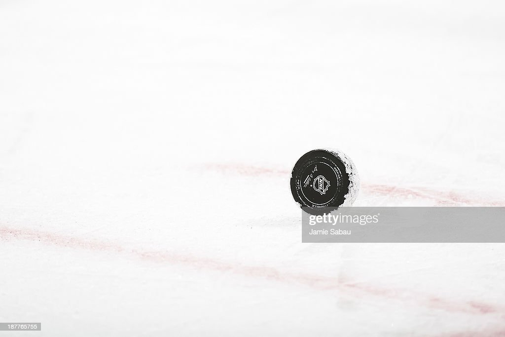 A National Hockey League game puck sits on the ice ready for a face off between the Columbus Blue Jackets and the New York Rangers on November 7, 2013 at Nationwide Arena in Columbus, Ohio.
