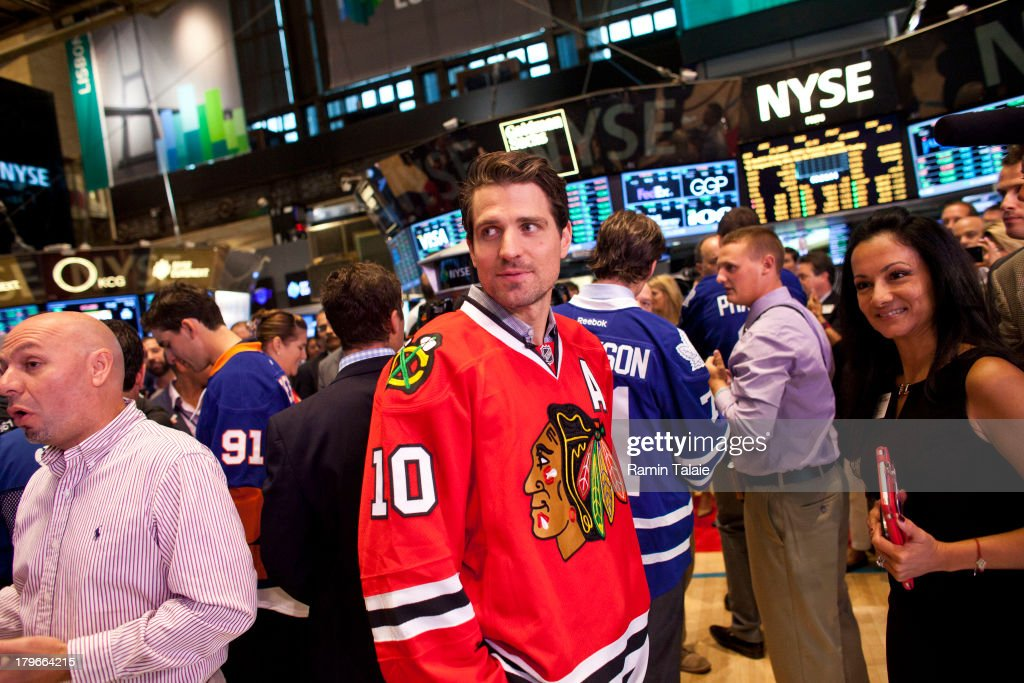 National Hockey League (NHL) player <a gi-track='captionPersonalityLinkClicked' href=/galleries/search?phrase=Patrick+Sharp&family=editorial&specificpeople=206279 ng-click='$event.stopPropagation()'>Patrick Sharp</a> of the Chicago Blackhawks speaks with traders on the floor of the New York Stock Exchange (NYSE) after ringing the opening bell on September 6, 2013 in New York City. NHL is celebrating the start of upcoming 2013-12 season featuring six outdoor hockey games.