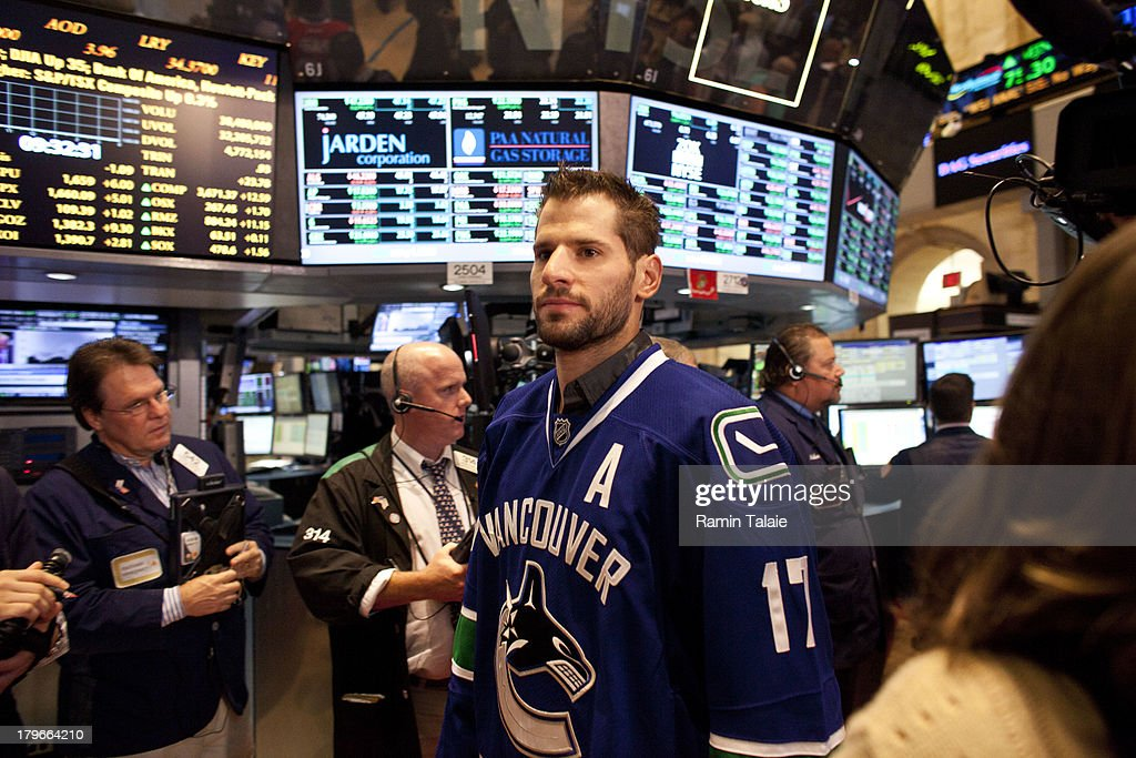 National Hockey League (NHL) player Ryan Kesler of the Vancouver Canucks walks on the floor of the New York Stock Exchange (NYSE) after ringing the opening bell on September 6, 2013 in New York City. NHL is celebrating the start of upcoming 2013-12 season featuring six outdoor hockey games.