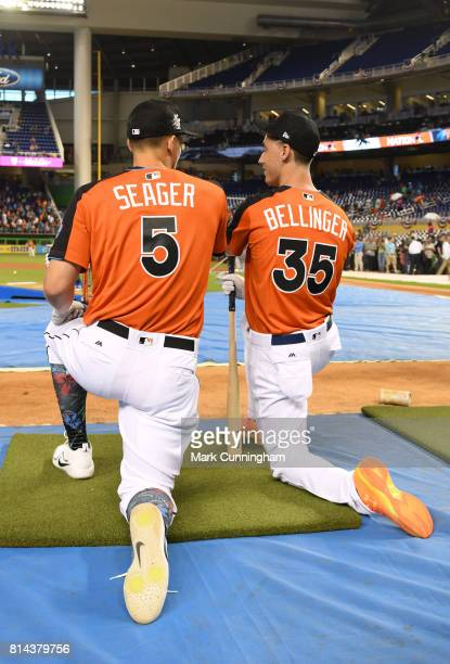 National League All Stars Corey Seager and Cody Bellinger of the Los Angeles Dodgers kneel together at the batting cage during the 2017 Gatorade...