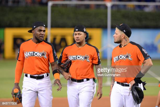 National League All Stars Marcell Ozuna of the Miami Marlins Carlos Martinez and Yadier Molina of the St Louis Cardinals talk during the 2017...