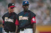 National League All Stars Vladimir Guerrero and Chipper Jones look on during the MLB AllStar Game on July 10 2000 at Turner Field in Atlanta Georgia