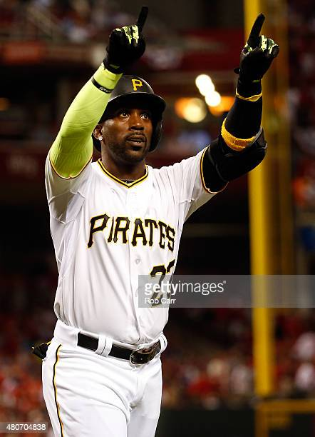 National League AllStar Andrew McCutchen of the Pittsburgh Pirates celebrates after scoring a solo home run in the sixth inning against American...