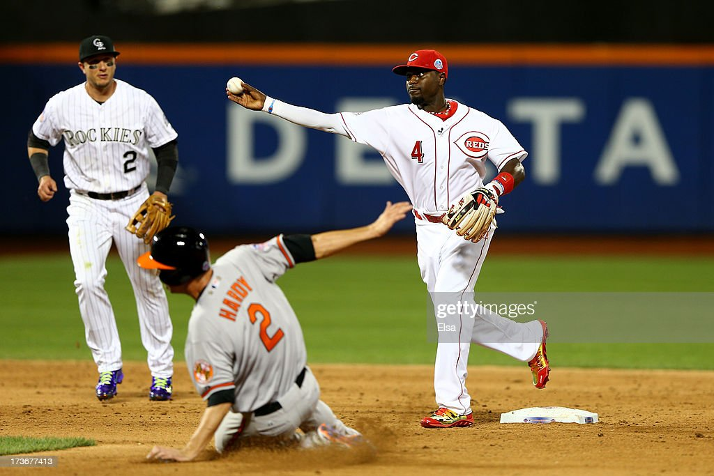 National League All-Star Brandon Phillips #4 of the Cincinnati Reds tries to turn a double play against American League All-Star J.J. Hardy #2 of the Baltimore Orioles during the 84th MLB All-Star Game on July 16, 2013 at Citi Field in the Flushing neighborhood of the Queens borough of New York City.