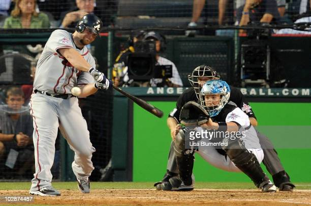 National League AllStar Brian McCann of the Atlanta Braves hits a three run double in the seventh inning during the 81st MLB AllStar Game at Angel...