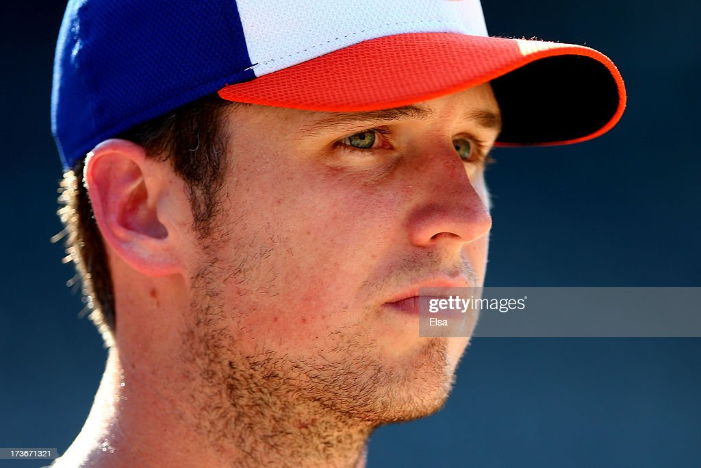 National League All-Star Buster Posey of the San Francisco Giants watches batting practice prior to the 84th MLB All-Star Game on July 16, 2013 at Citi Field in the Flushing neighborhood of the Queens borough of New York City.