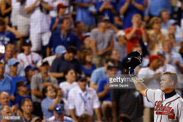 National League AllStar Chipper Jones of the Atlanta Braves takes off his helmet and waves to the crowd during his at bat in the sixth inning during...