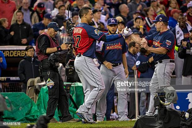 National League AllStar Giancarlo Stanton and Mike Redmond of the Miami Marlins during the Gillette Home Run Derby at Target Field on July 14 2014 in...