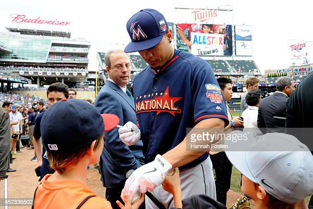 National League AllStar Giancarlo Stanton of the Miami Marlins signs autographs before the 85th MLB AllStar Game at Target Field on July 15 2014 in...