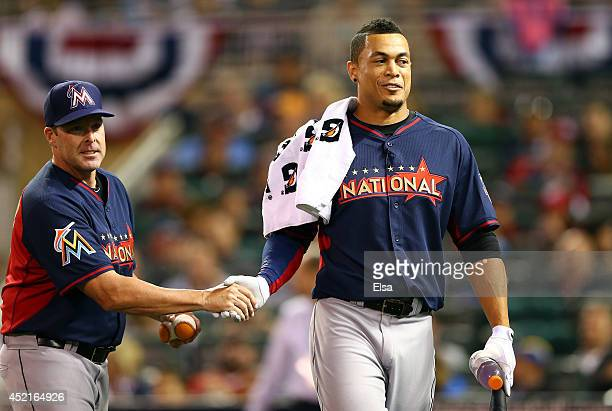 National League AllStar Giancarlo Stanton of the Miami Marlins speaks with Marlins manager Mike Redmond during the Gillette Home Run Derby at Target...