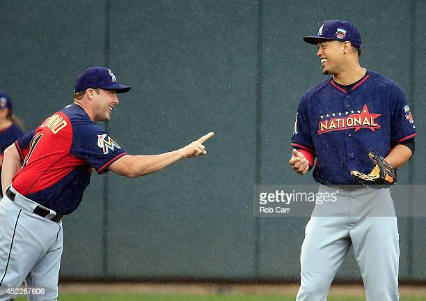 National League AllStar Giancarlo Stanton of the Miami Marlins speaks with Marlins Manager Mike Redmond during the Gatorade AllStar Workout Day at...