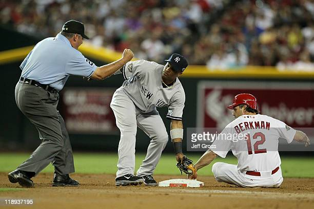 National League AllStar Lance Berkman of the St Louis Cardinals is tagged out at second base by American League AllStar Robinson Cano of the New York...