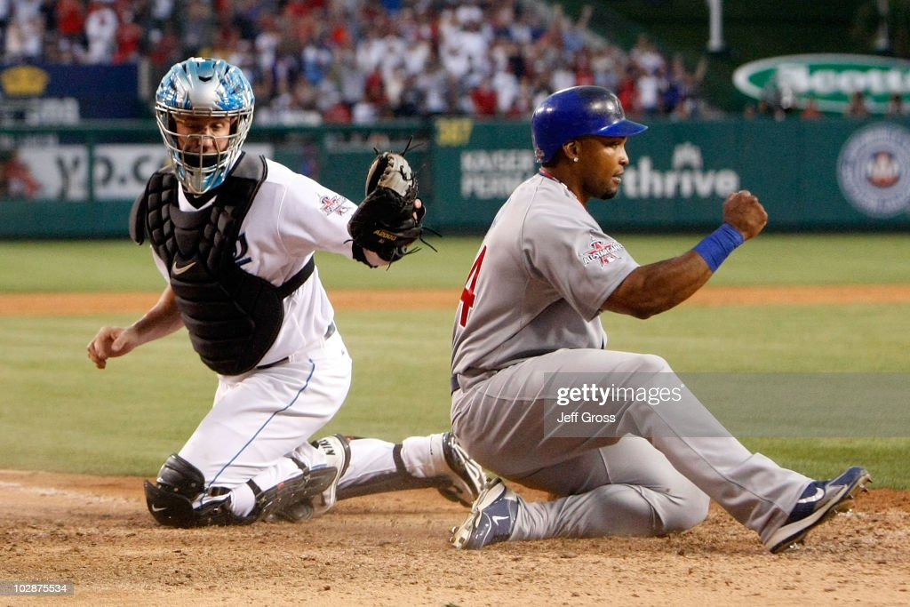National League All-Star <a gi-track='captionPersonalityLinkClicked' href=/galleries/search?phrase=Marlon+Byrd&family=editorial&specificpeople=217377 ng-click='$event.stopPropagation()'>Marlon Byrd</a> #24 of the Chicago Cubs reacts after sliding in safe at home plate to score the third run for the National League in the seventh inning of the 81st MLB All-Star Game at Angel Stadium of Anaheim on July 13, 2010 in Anaheim, California.