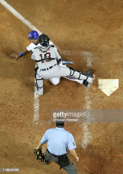 National League AllStar Starlin Castro of the Chicago Cubs is tagged out at home plate by American League AllStar Alex Avila of the Detroit Tigers in...